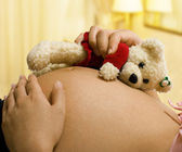 Expectant Mother Holding a Teddy Bear — Stock Photo