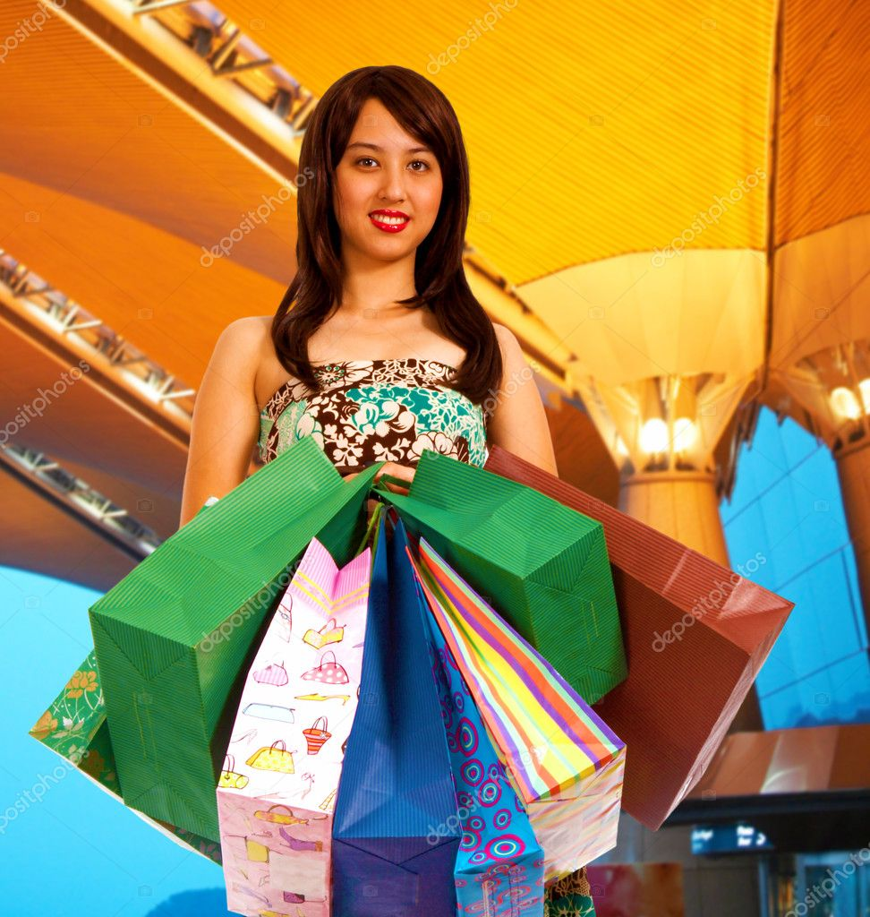 Girl after shopping spree holding lots of shopping bags — Stock Photo #6670760