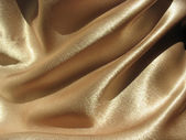 Draped gold satin background — Stock Photo