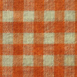 Stock Photo: Orange checkered canvas texture - fabric background