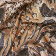 Draped brown multicolored fabric with spangles — Stock Photo