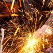 Worker cutting metal with many sharp sparks — Stok fotoğraf