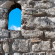 Royalty-Free Stock Photo: Castle wall with window in it