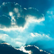 Stock Photo: Sun striking trough clouds