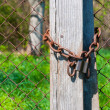 Stock Photo: Old padlock with chains onb wooden fence
