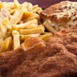 Cordon bleu with fries and cheese — Stock Photo