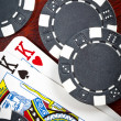 Stock Photo: Pair of kings and some tokens on wood background