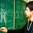Young student showing spinal chord on green chalk board — Foto Stock