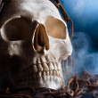 Human skull with chain and smoke — Stock Photo #5683483