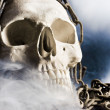 Human skull with chain and smoke — Foto Stock