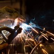 Worker welding steel with white sparks — Stock Photo