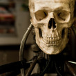 Human skull on robot body close up — Stock Photo #5683493