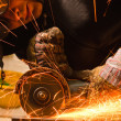 Worker cutting metal with many sharp sparks — Stock Photo #5683510