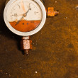 Gas meter against rusty background - Stock Photo