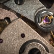 Closeup of small metal cogs - Stockfoto