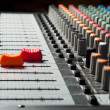 Part of an audio sound mixer with buttons and sliders — Stock Photo #5683645