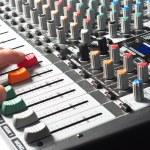 Sound mixer with hand using slider — Stock Photo