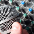 Sound mixer with microphone and hand — Stock Photo
