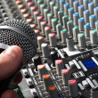 Sound mixer with microphone and hand — Stock Photo #5683676