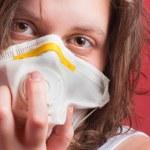 Girl wearing protective mask — Stock Photo #5683994