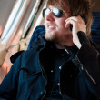 Handsome young man traveling on old airplane with phone at his e — Stock Photo