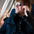 Handsome young man traveling on old airplane with phone at his e — Stockfoto