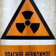 Stock Photo: RussiBeware of radiation sign in metal
