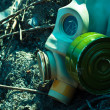Stock Photo: Vintage gasmask on burnt down ground