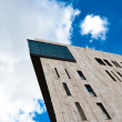 Modern building angle shot against blue sky — Stock Photo