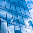 Modern office building with reflection of the sky — Stock Photo