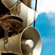 Stock Photo: Loudspeakers against blue sky