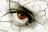 Dark art texture of a woman's eye with cracks — Stock Photo