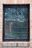 Old window closeup with bars on it — Stock Photo