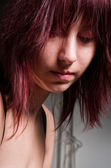 Beautiful young girl looking depressed — Stock Photo