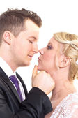 A couple on their wedding day kissing and laughing — Stock Photo