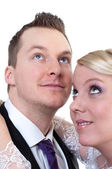 Bride and groom looking above — Stock Photo
