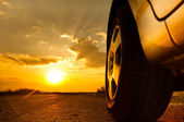 Close up shot of a car against sunset in the background — Stock Photo