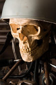 Close up of a robot with human skull and helmet — Stock Photo