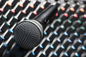 Part of an audio sound mixer with a microphone — Stock Photo