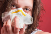 Girl wearing protective mask — Stock Photo