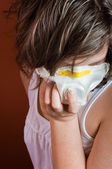 Girl wearing protective mask against flu or radiation — Stock Photo