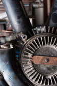 Cog and other rusty metal parts — Stock Photo