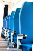 Blue seats of an Airplane with blurry background — Stock Photo