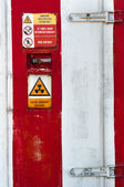 Closed Door of a nuclear facility with signs on it — Stockfoto