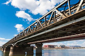 Angle view of a rusty bridge against blue sky — Stok fotoğraf