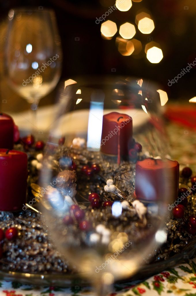Candles and glasses with burry out of focus background — Stock Photo #5682891