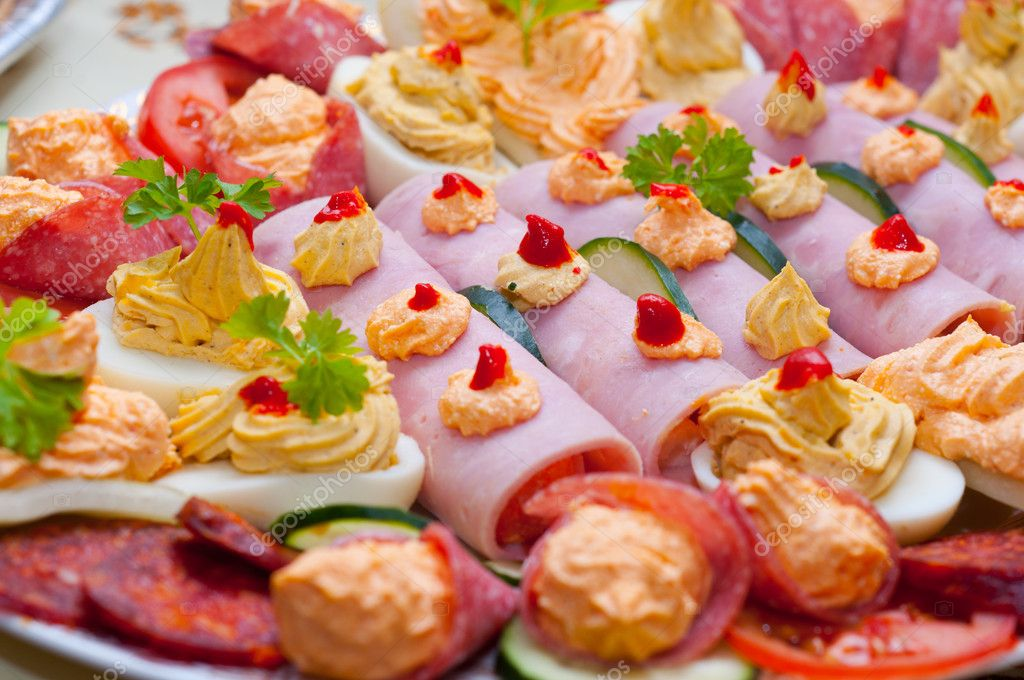 Traditional food made out of ham eggs and paste with vegetable — Stock Photo #5683076