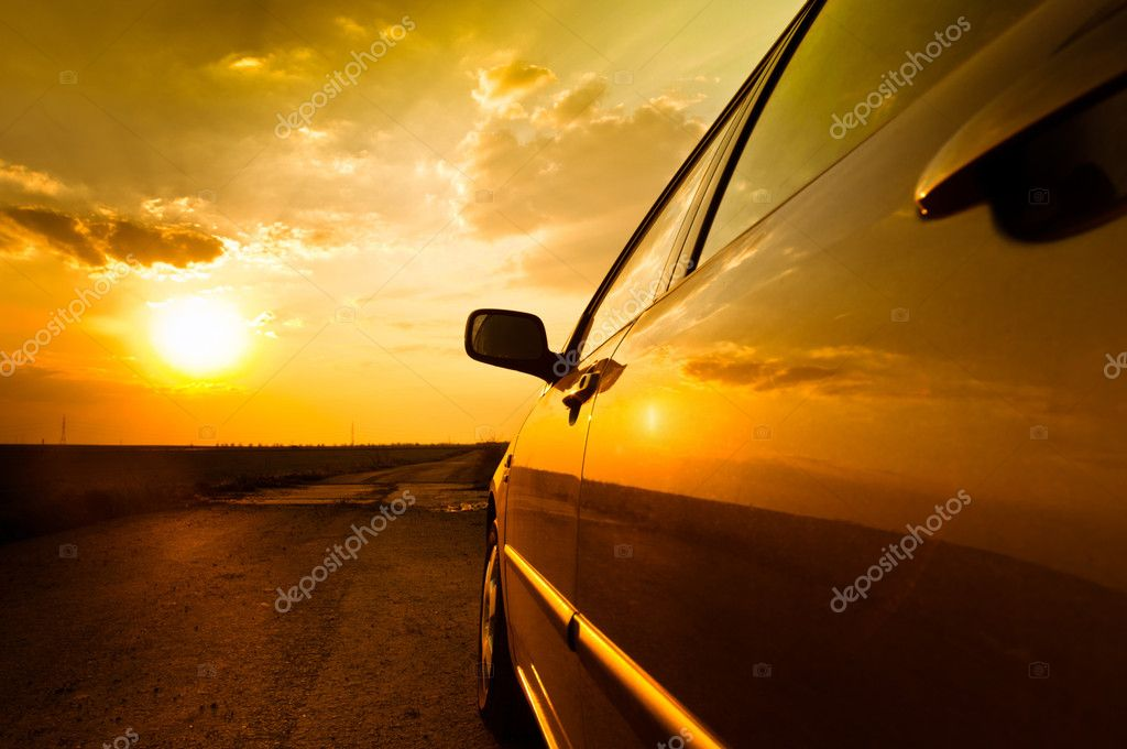 Angle shot of a car against sunset in the background — Stock Photo #5683420