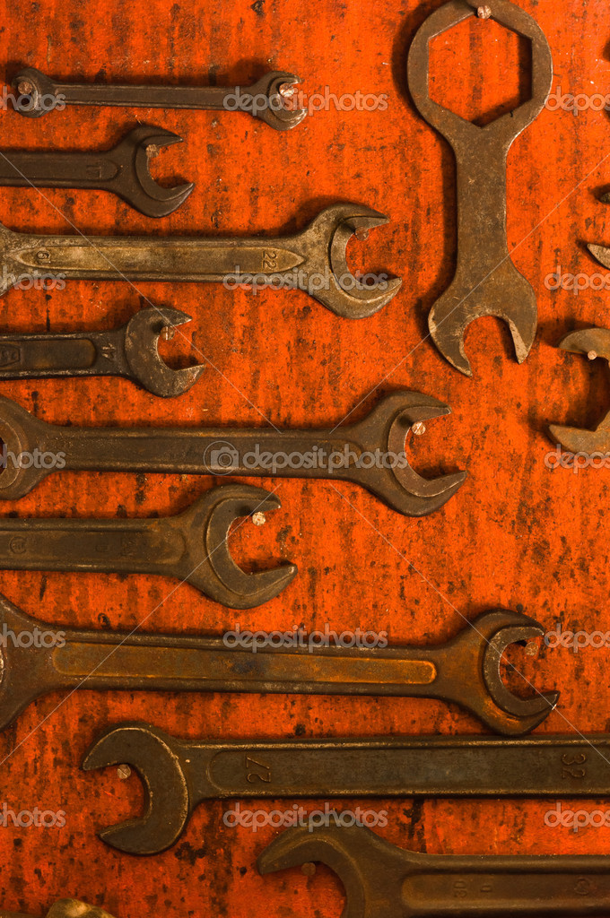 Many rusty spanners on wooden board — Stock Photo #5683533