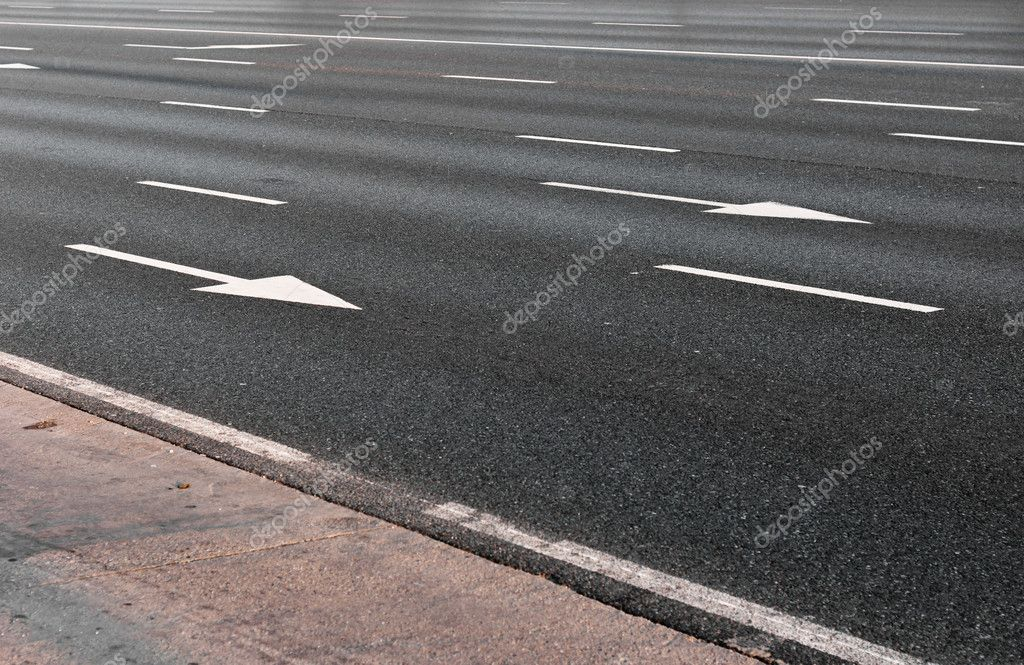 Arrow direction on asphalt — Stock Photo #5684106